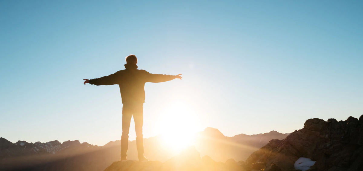 Header image of man against the sunset having achieved his goals in 2018 using locus of control