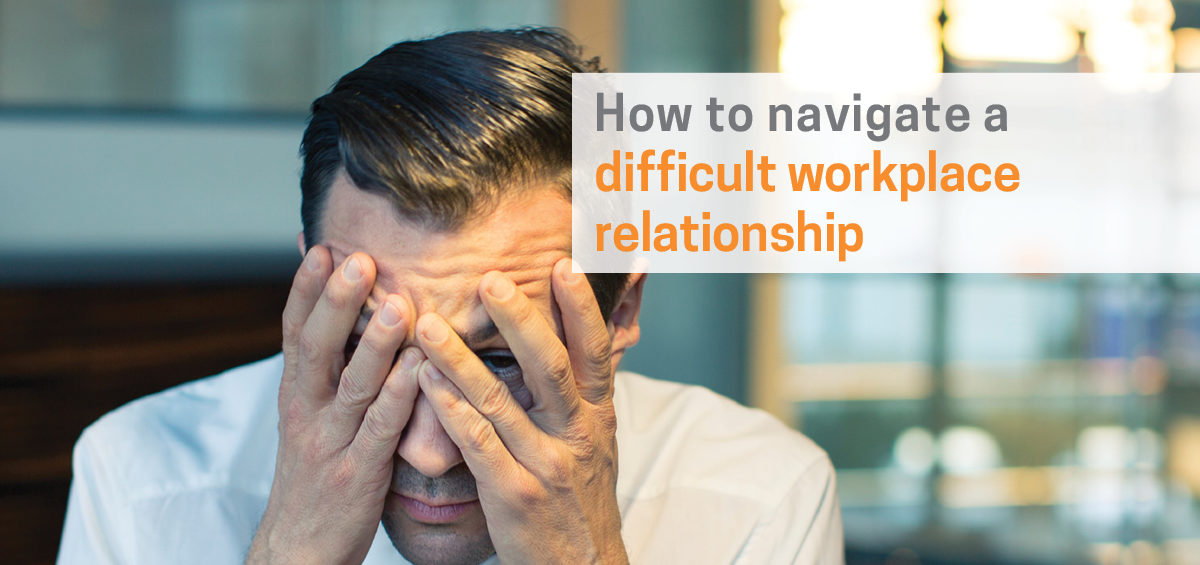 Header image of corporate man with head in hands for article on How to Deal with Difficult People at Work